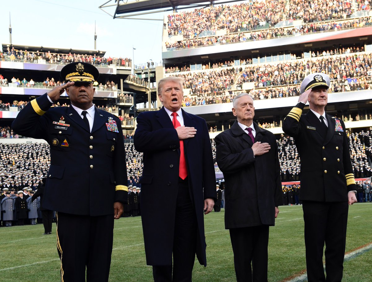 President Donald Trump, second from left, is joined by, from left, West Point Superintendent Lt. Gen. Darryl A. Williams, Defense Secretary Jim Mattis and Naval Academy Superintendent Vice Adm. Ted Carter, during the playing of the national anthem before the start of the Army-Navy NCAA college football game in Philadelphia, Saturday, Dec. 8, 2018. [AP Photo]