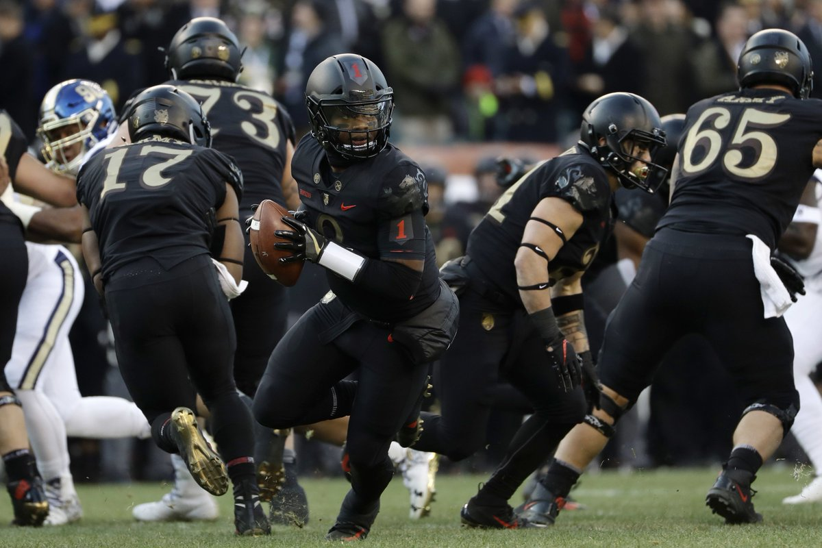 Army's Kelvin Hopkins Jr. drops back during the first half of an NCAA college football game against Navy, Saturday, Dec. 8, 2018, in Philadelphia. [AP Photo]