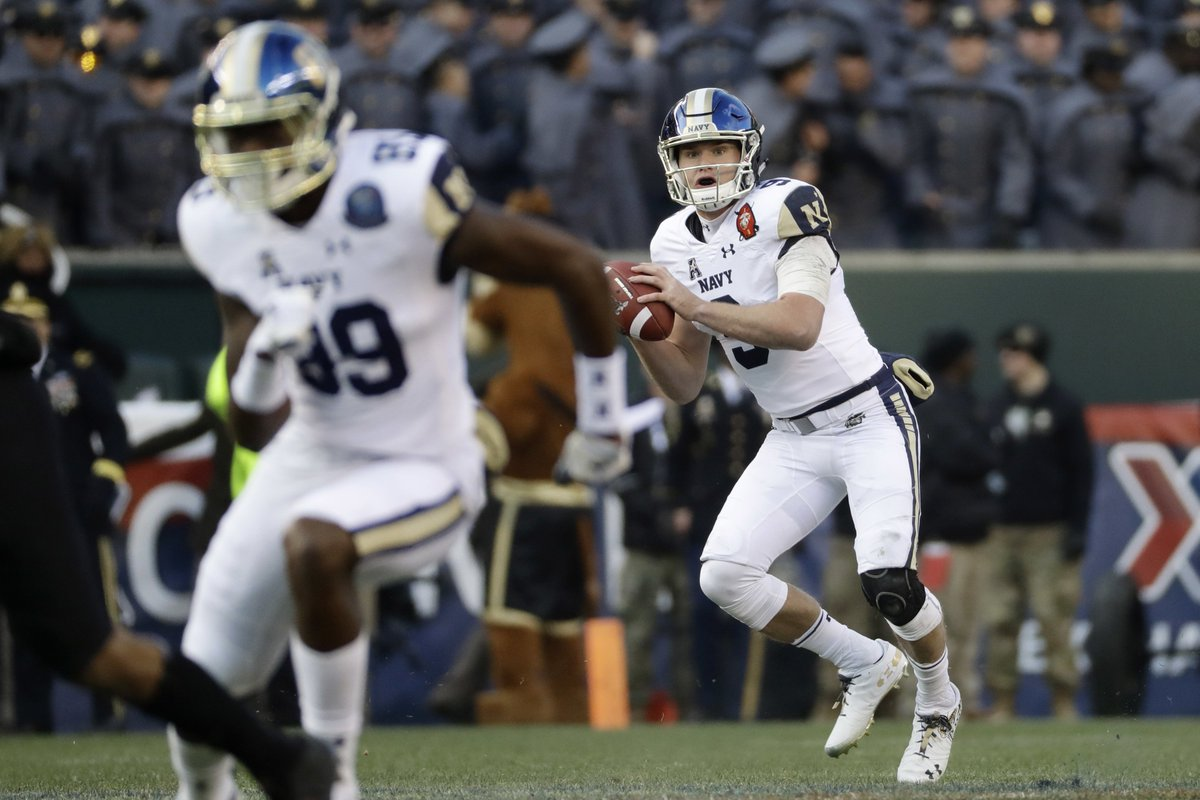 Navy's Zach Abey looks to pass during the first half of an NCAA college football game against Army, Saturday, Dec. 8, 2018, in Philadelphia. [AP Photo]