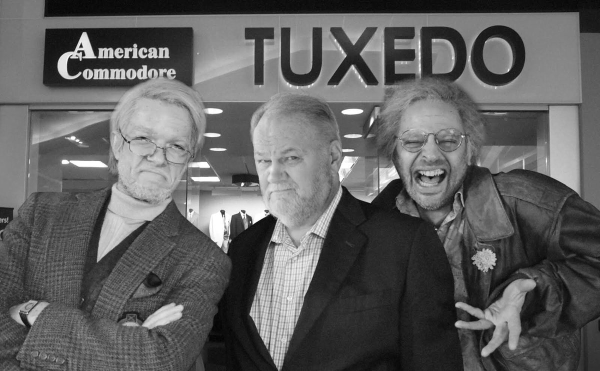A previously published paparazzi photo of George & Gil and Meghan Markles dad Thomas Markle getting fitted for Oscar Host tuxes has been revealed to be staged. ABC will not confirm that they have any idea who these men are or what is going on.
