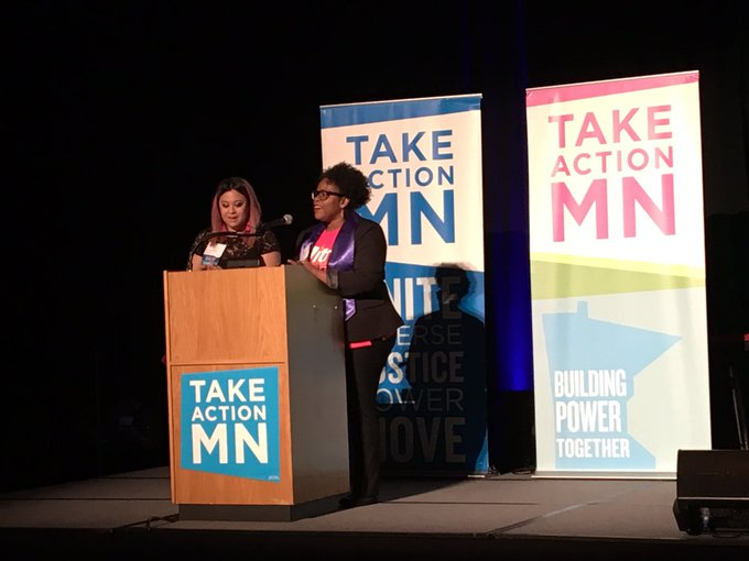 TakeAction Minnesota members and graduates of our Public Leadership Institute @mitrajnelson and @voteconley co-emceeing tonight's program ❤️ #PeoplesParty18 Photo