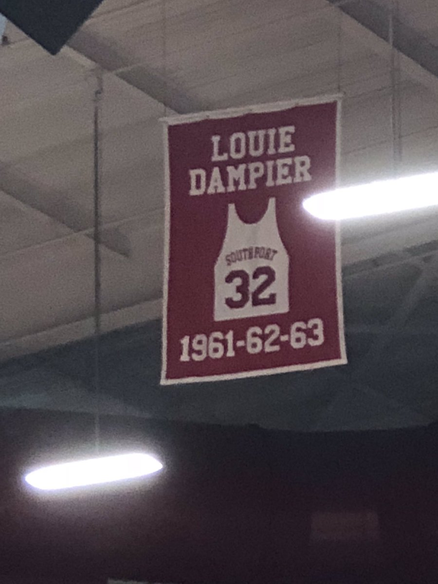 I'm down after today's loss but have to keep working so I go to a high school game and whose name is in the rafters?!? Made me smile. Louie, you are the best