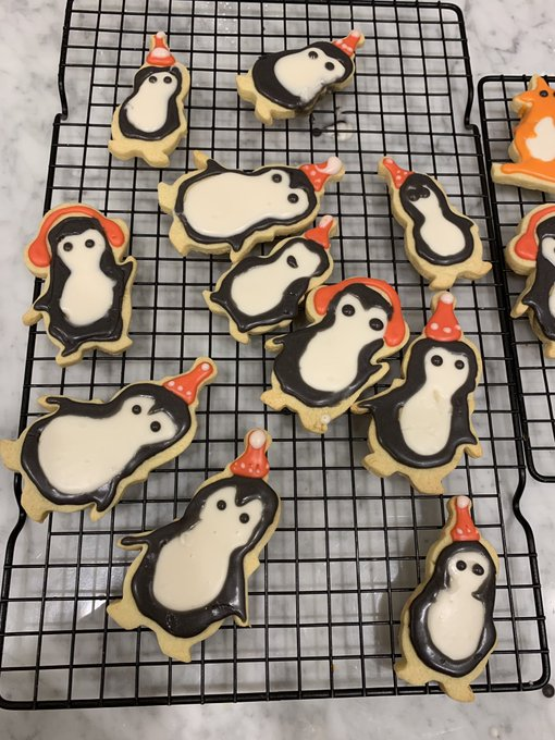 This is my first time with royal icing and it's a bit of a mess, but I love how my penguins look. I haven't put their beaks on yet and they looks like some kind of Miyazaki forest spirits Photo