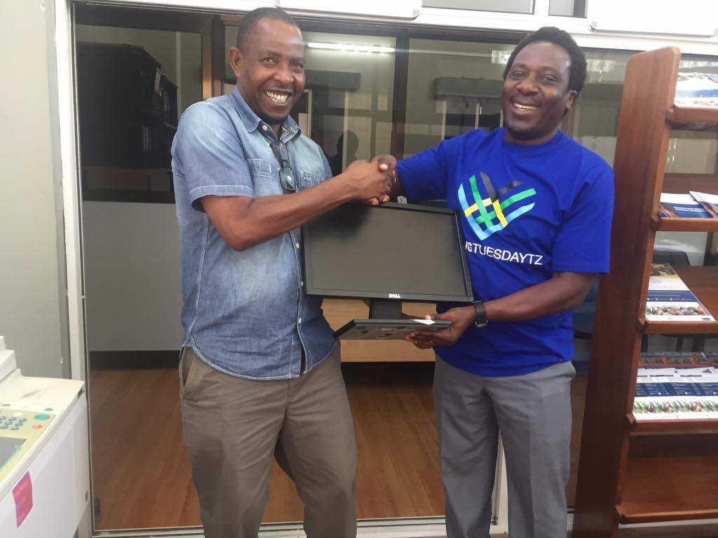 Executive Director of Foundation for Civil Society (FCS) receiving a donation of 4 computers from a representative from policy forum, for giving Tuesday! #givingtuesday  @FCSTZ @KiwangaFrancis @geline_gee @GivingTuesdayTZ