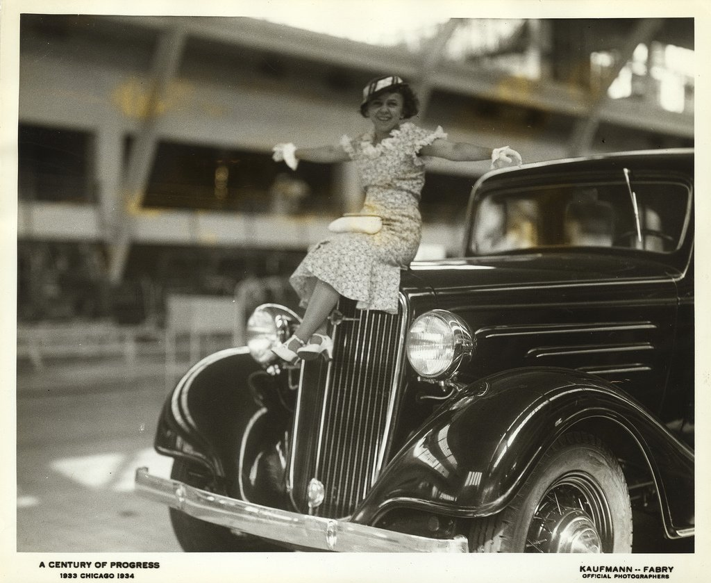 Via UIC Library Digital Collections: Miss Gladys Farkes, 27 years old and 47 inches tall, thinks she would make a good radiator cap for the 1934 Chevrolet. Miss Fawkes was a visitor in the General Motors Building. #transportationtuesday #centuryofprogress #generalmotorsbuilding