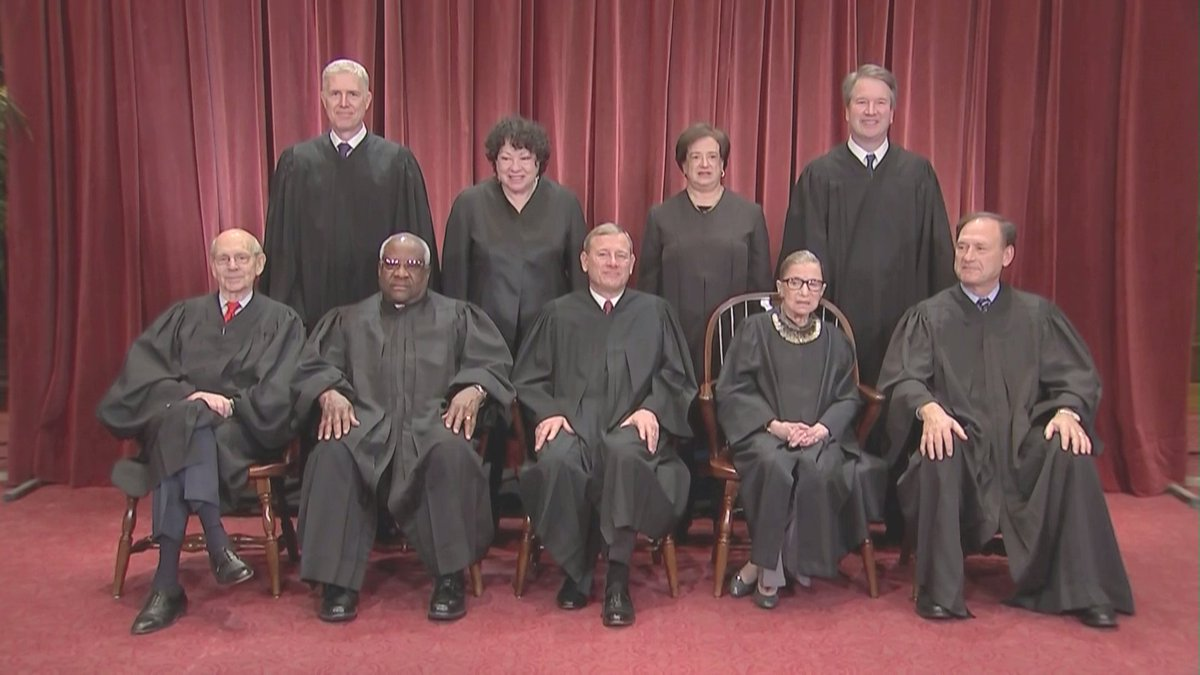US Supreme Court poses for new class photo this morning, with its newest member, Brett Kavanaugh, smiling broadly.