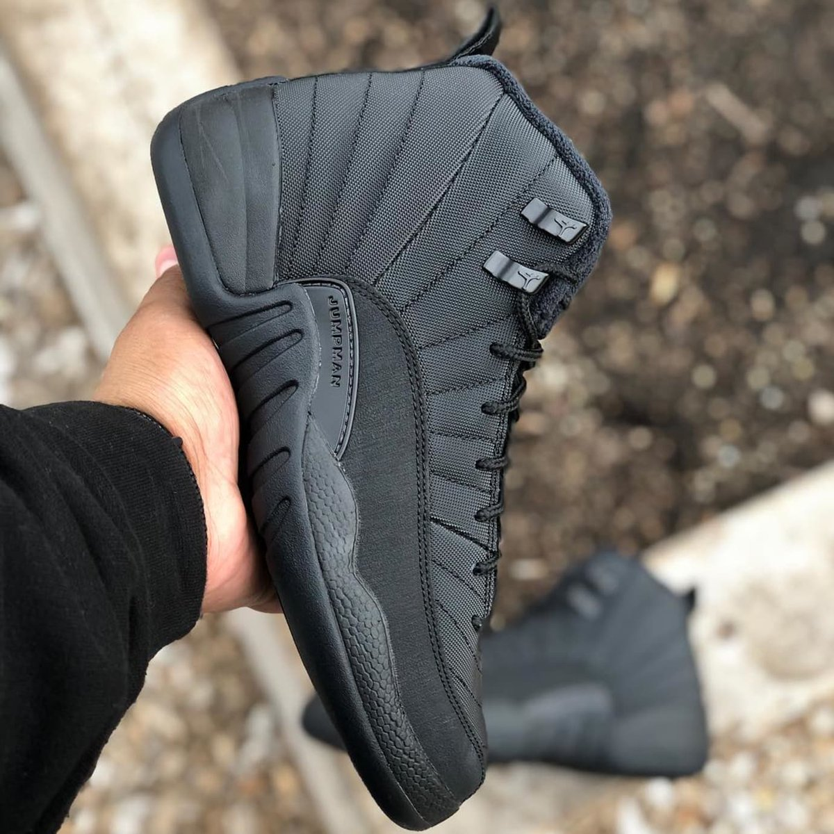 b6fa6aa1c70 The winterized Air Jordan 12 ($265) drops tomorrow in all-black featuring a  durable, water-repellant upper and an inner fleece lining to keep you warm  this ...