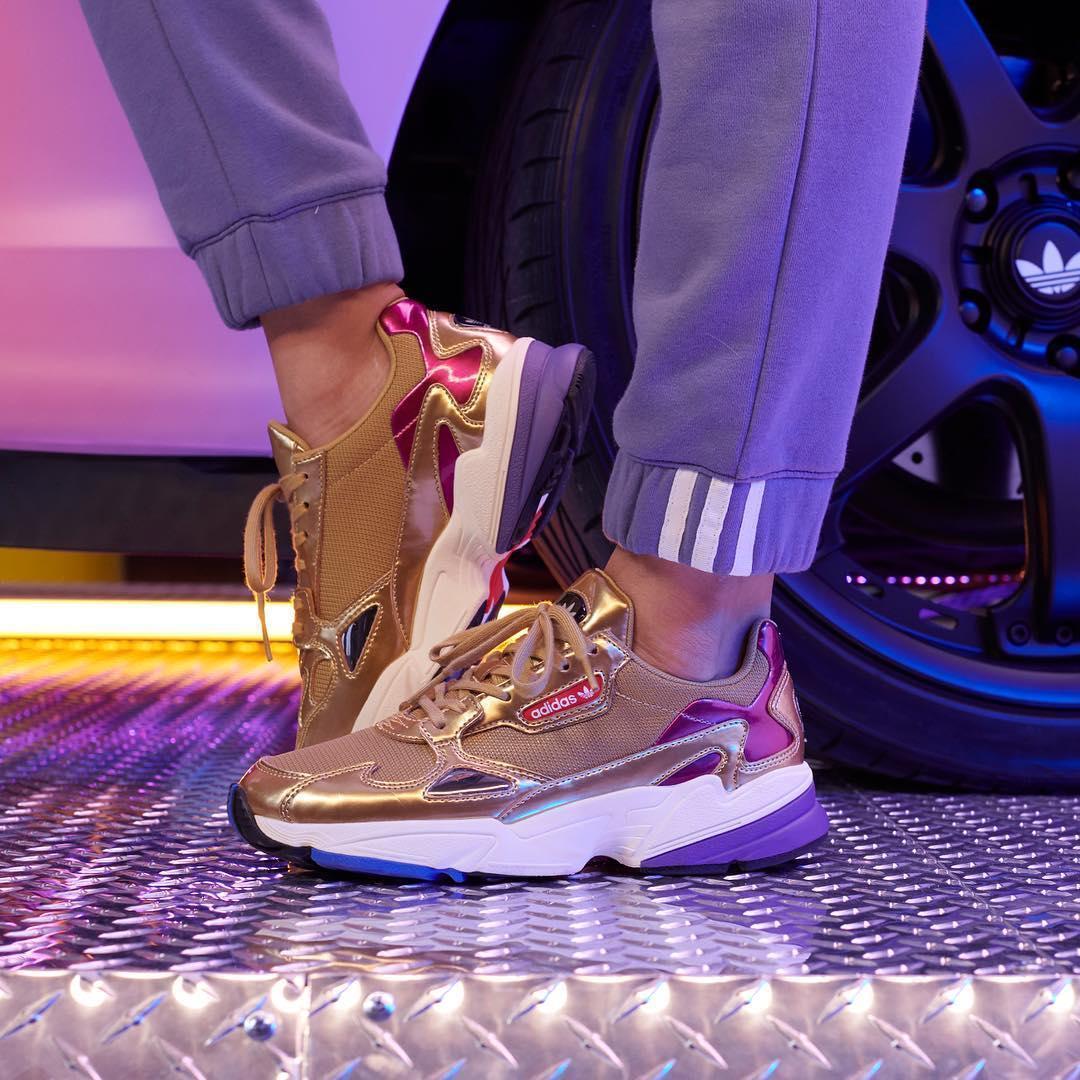 gold pair of adidas Falcons