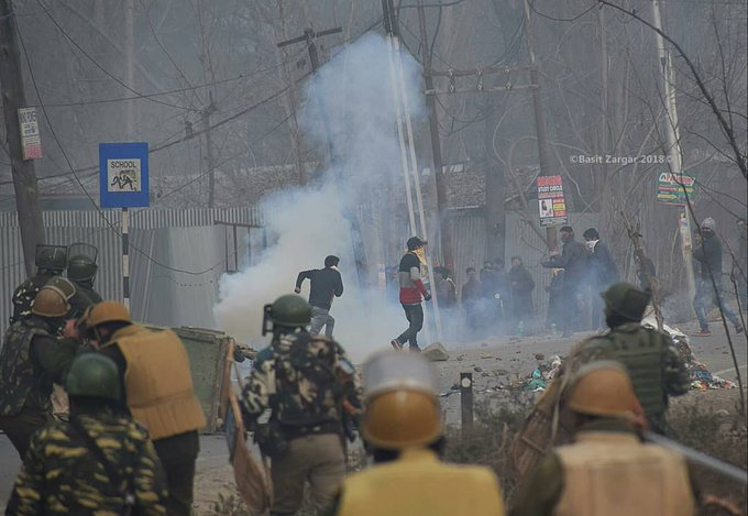Clashes erupted between protesters and security forces near the encounter site at Mujgund area on the outskirts of Srinagar. Photo