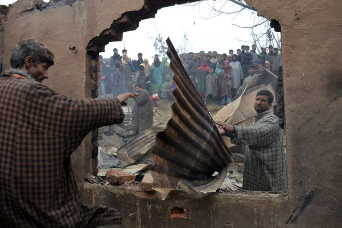 Dec 09,2018 -Kashmiri people inspect war ravaged houses where militants were holed up during gun battle with the Indian government forces in Mujgund area of Srinagar. Fourteen year old boy was among the three militants killed in the gun then Six houses were also damgd Photo