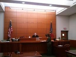Man attacks cops, eats court paperwork off wall