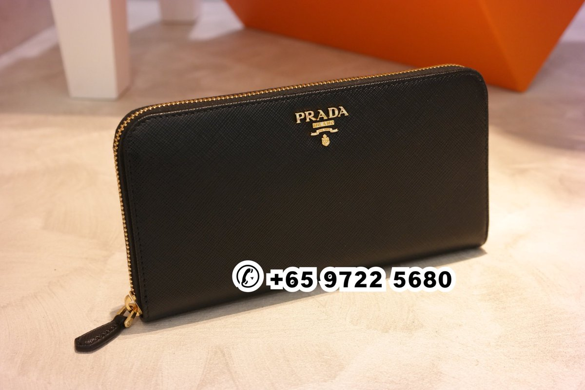 441b125b592 ... Prada Saffiano Zip Around Wallet Black 1ML506 QWA F0002 Size  20 x 10  cm Material  Saffiano Calf Leather Mobile  +65 9722 5680 Email  info  revelabel.com ...