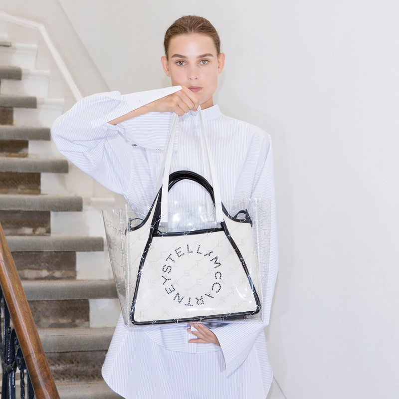 Our signature logo tote gets a modern update with a layer of clear  monogram—this season s go-to statement. All of our transparent accessories  are made from ... 9c4070f06ab36