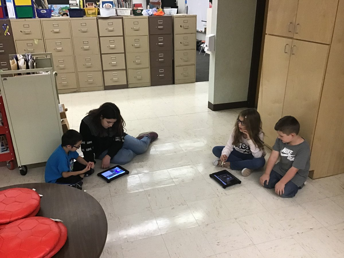 Coding with our new friends from Ms. Bowen's class. #HourOfCode #celebratelps @CitrusSchools