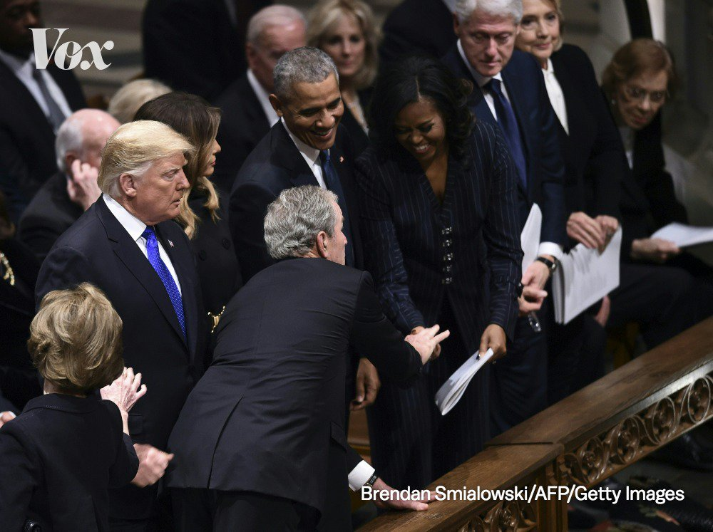 George W. Bush slipped something into Michelle Obama's hand as entered the Cathedral.   (At John McCain's funeral, he famously handed her a piece of candy). #GeorgeHWBushFuneral