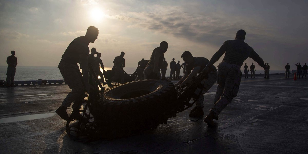 PT … Good For You, Good For Me Marines with Marine Fighter Attack Squadron 211, @Official13thMEU, carry a tire while participating in a squad competition on the flight deck aboard the Wasp-Class amphibious assault ship USS Essex (LHD 2).