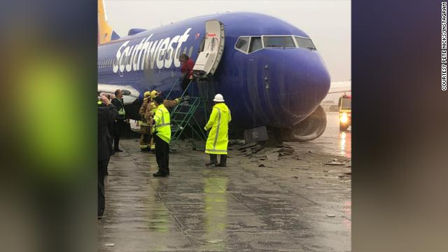 A Southwest Airlines flight slid off a runway at California's Hollywood Burbank Airport during heavy rain, the FAA says. No injuries are reported. https://cnn.it/2E23VYG