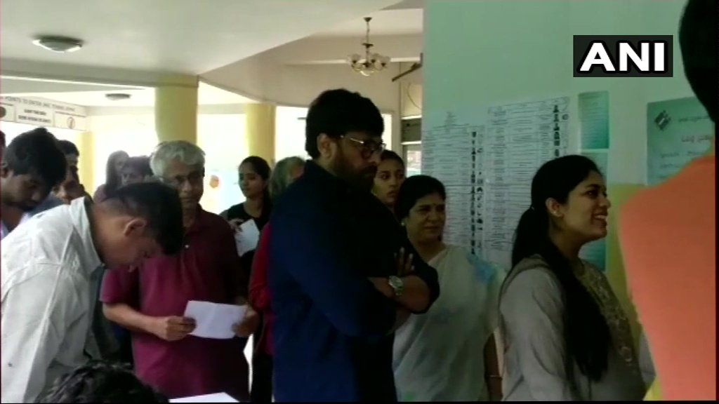 Actor Chiranjeevi stands in a queue to cast his vote at polling booth no. 148 in Jubilee Hills, Hyderabad. #TelanganaElections2018