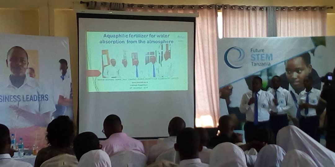"The Last Presentation for today from Baobab Boys Secondary School with a product ""Aquaphilic Fertilizer for water absortion from the atmosphere""  They are soliving a proplem of the effect of drought in crop production in area with shortage of water #FutureStemTz @PhysicsNews<br>http://pic.twitter.com/8mnK76MxVI"