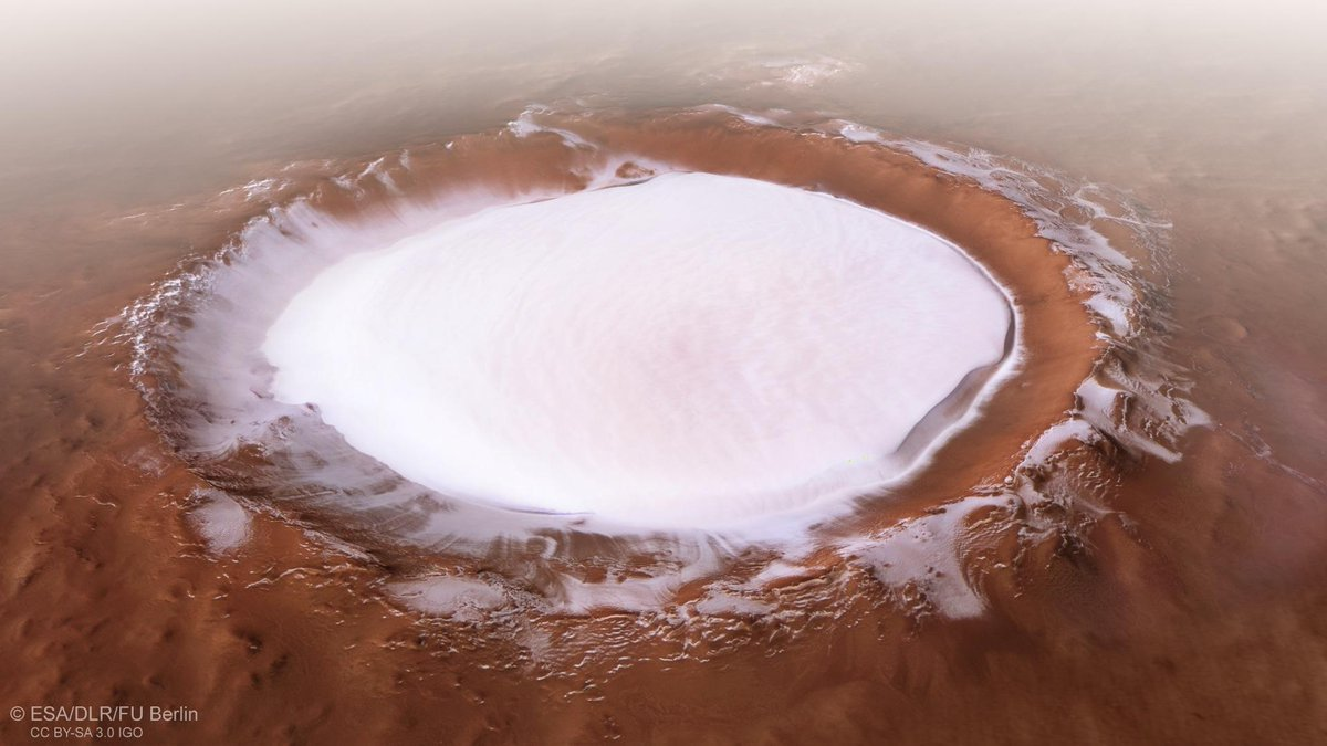 A beautiful #winter wonderland... on #Mars! This ice-filled crater was imaged by our Mars Express spacecraft. Korolev crater is 82 kilometres across and found in the northern lowlands of Mars. More images:  https://t.co/48Czjh80Qb