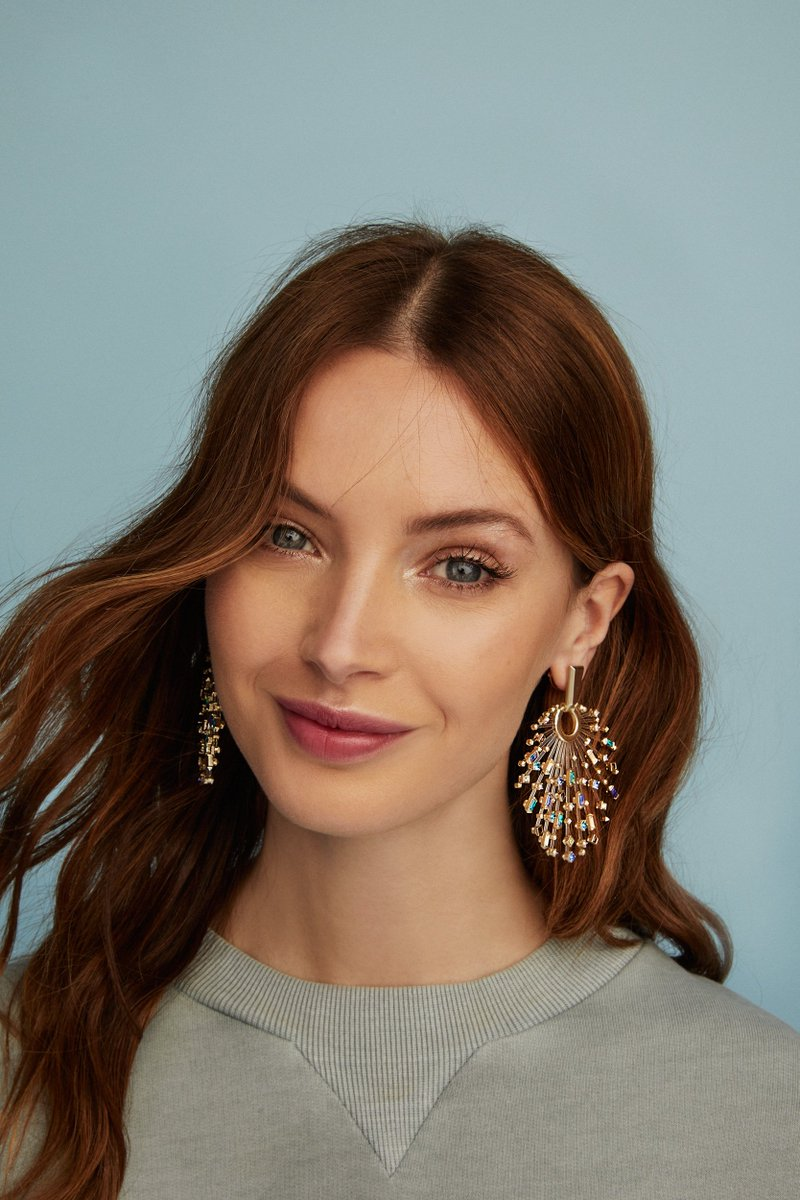 a89770050 These statement earrings feature an arrangement of hand-place pave  crystals, held together with thin acrylic rods that create a beautiful  floating illusion. ...
