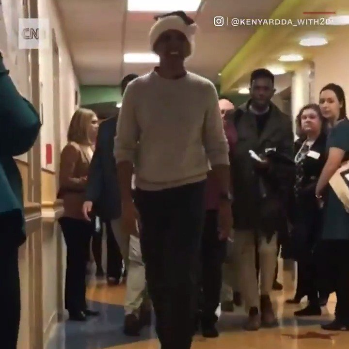 """Former President Barack Obama visited Children's National Medical Center in Washington, D.C., wearing a Santa hat and carrying a bag of gifts. Obama also led patients and staff in a """"We Wish You a Merry Christmas"""" sing-along."""