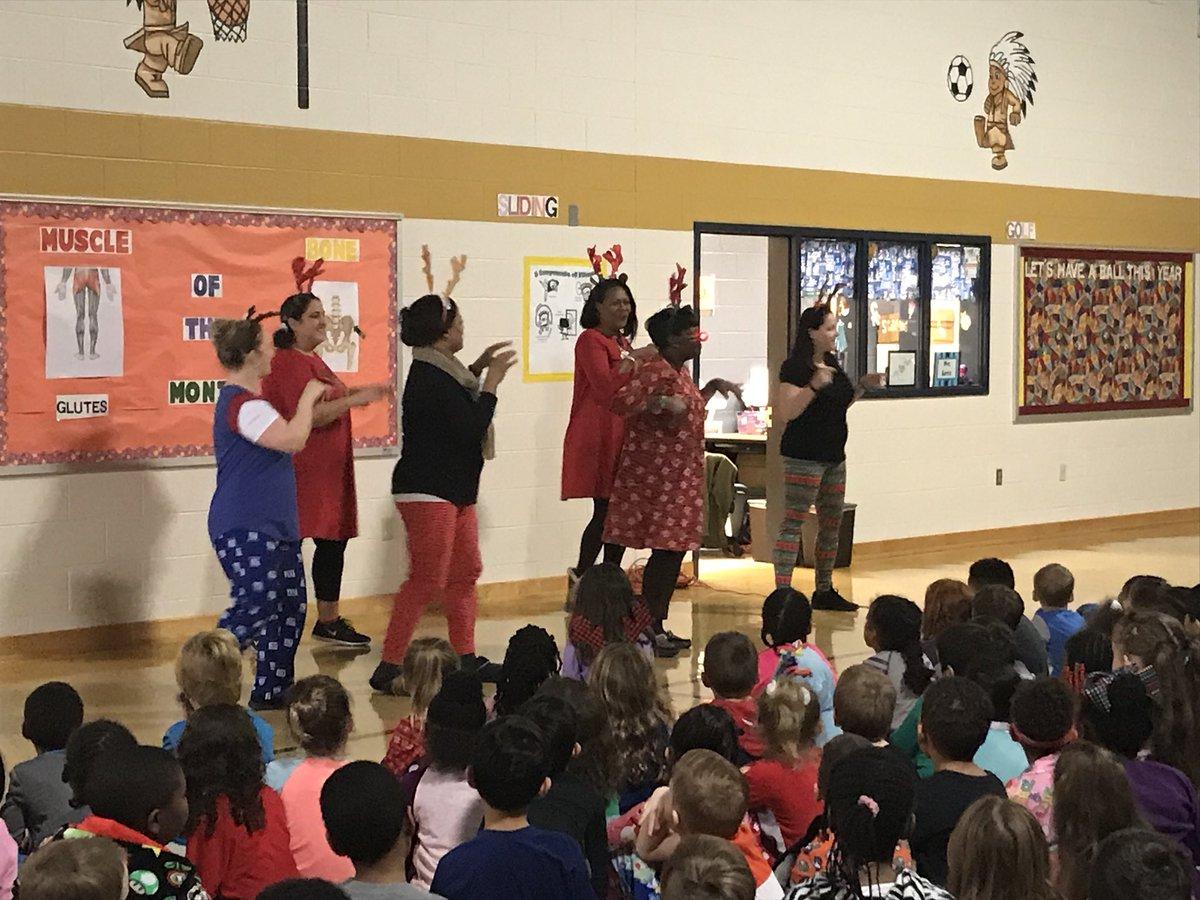 2nd grade teachers performing Rudolph the Red Nose Reindeer @vbschools @WOESVB