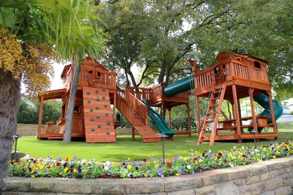 fort stockton playset bridged to tree deck and with crawl tube for kids.