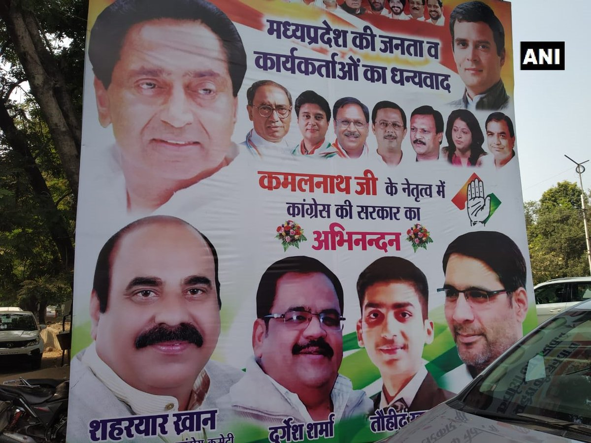 Poster seen outside Madhya Pradesh Congress Committee office in Bhopal. #MadhyaPradeshElections2018