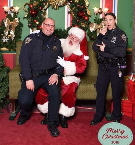 Some people might say you're never too old to sit on Santa's lap, but judging by his face in this picture, we may have to disagree!  Officers Carlino and Marra from the @NYPD121Pct in #StatenIsland stopped to visit Santa to make sure he got their letters in the mail.