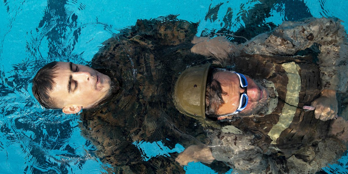 I Got You, Buddy Marines attending a Marine Corps Instructor Course of Water Survival perform a simulated rescue at the base pool, @MCB_Hawaii, Dec. 5, 2018.