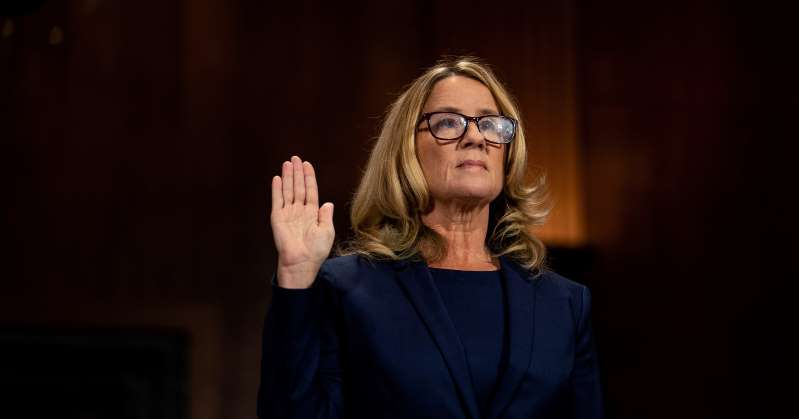 a man wearing glasses and smiling at night: Christine Blasey Ford swears in at a Senate Judiciary Committee hearing for her to testify about sexual assault allegations against Supreme Court nominee Judge Brett Kavanaugh on Capitol Hill in Washington on Sept. 27. | Erin Schaff for <br>http://pic.twitter.com/GTHdB2squo