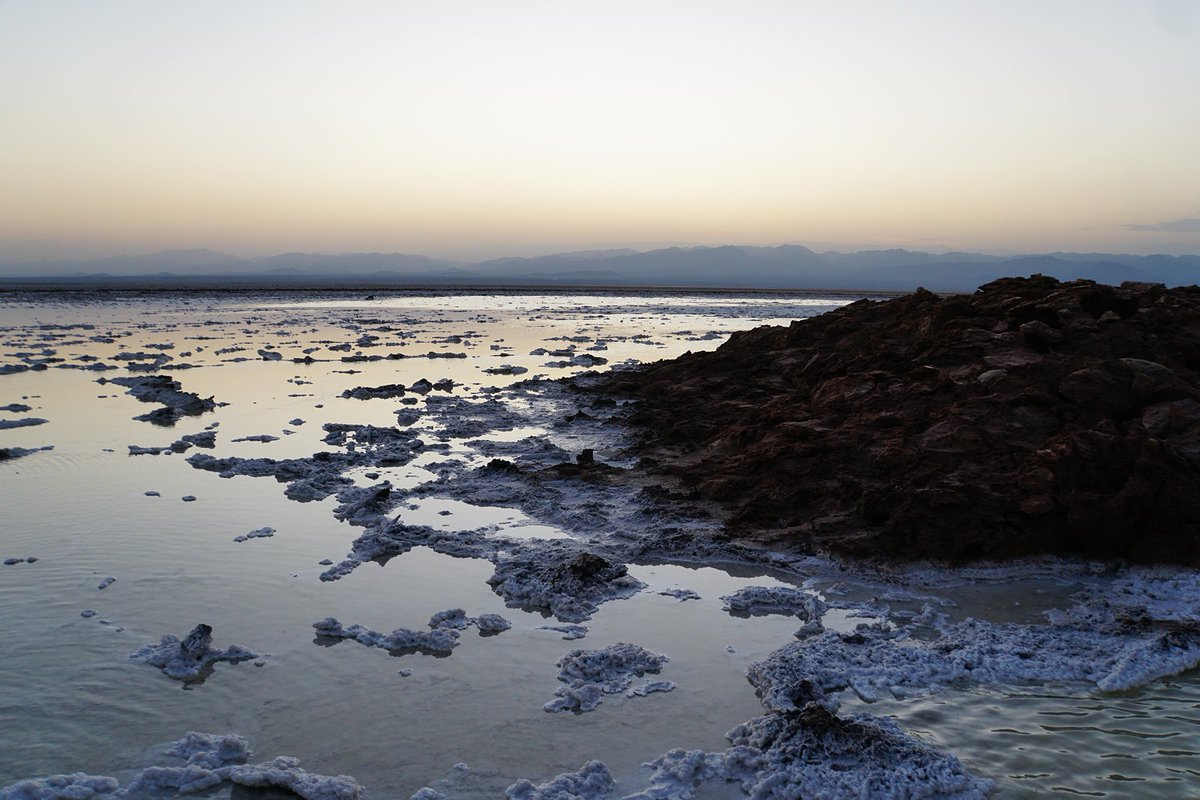 NEW BLOG: The Danakil Depression in Ethiopia is one crazy landscape, from the fluorescent Dallol to the white salt plains of Lake Asale by sunset, it's like another planet  https://www. wandersmiles.com/dallol-hot-ali en-landscape-ethiopia/   …  #danakildepression #visitethiopia #adventuretravel<br>http://pic.twitter.com/3I2Ta1TtQT