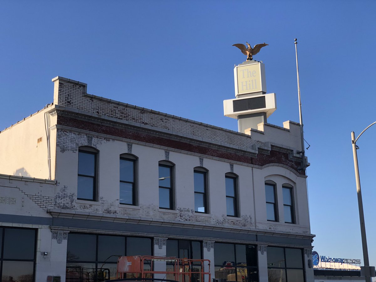 The days of the white paint over the red brick at the BMO Harris Bank at Southwest and Kingshighway are numbered. The red brick is showing along the top. It looks great! <br>http://pic.twitter.com/Mmla5YNzdc