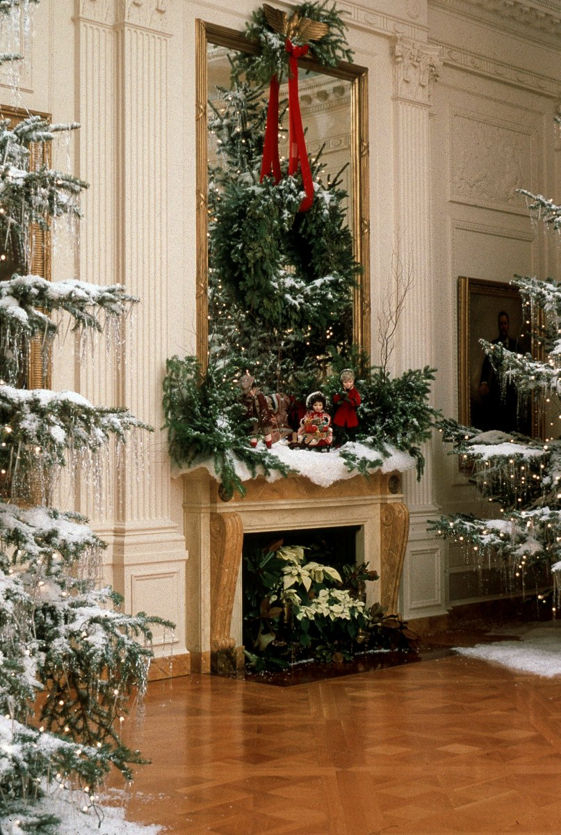 The East Room mantel was decorated with flocked trees and sledding dolls for Christmas, 1985.