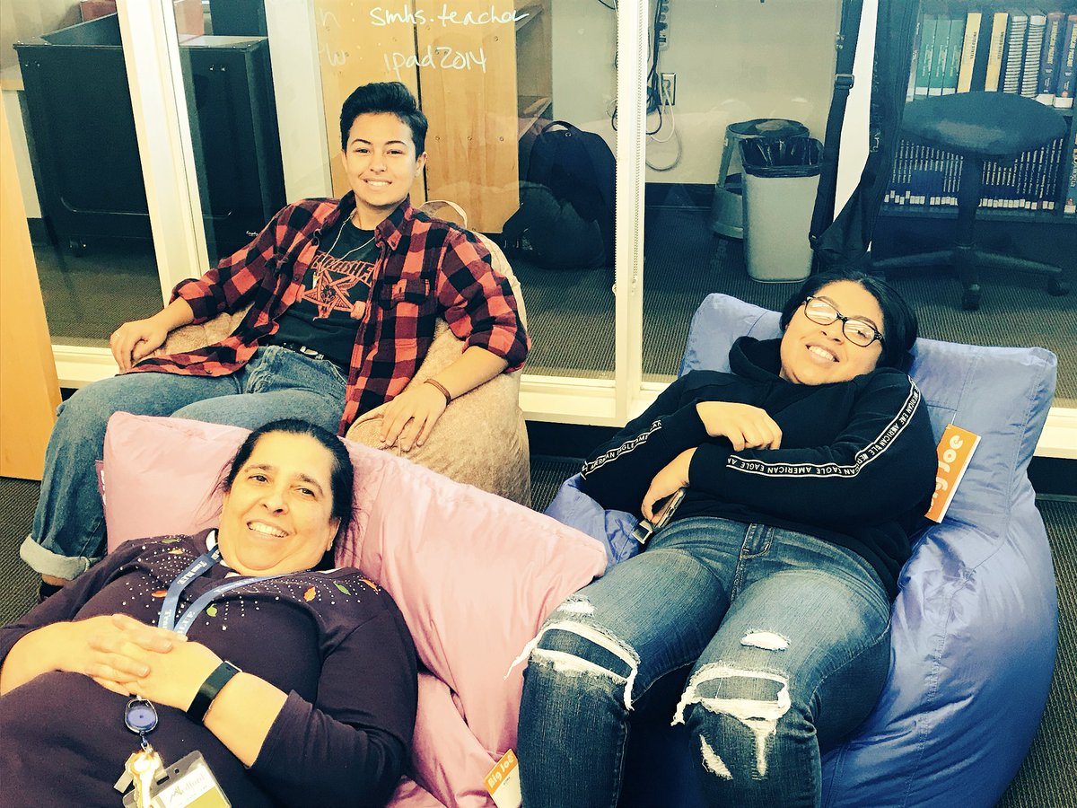 Testing out our new beanbags in the @SMHS_Pride library!