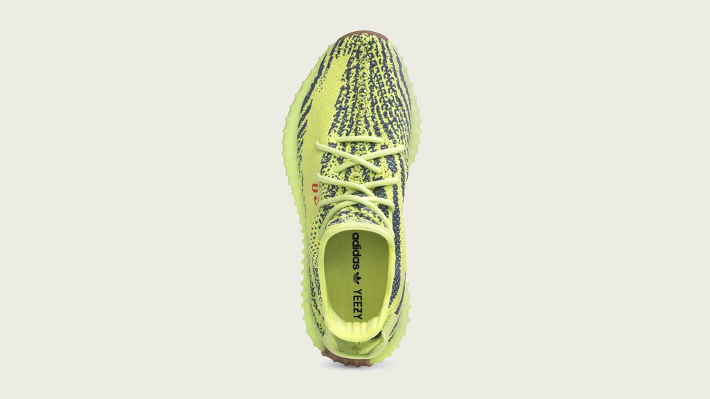 0a6fe9ce795 The  adidasOriginals YEEZY BOOST 350 V2 Semi Frozen Yellow Grey Steel Red  is almost here! ( 4 emoji) days and counting. Are these a must cop