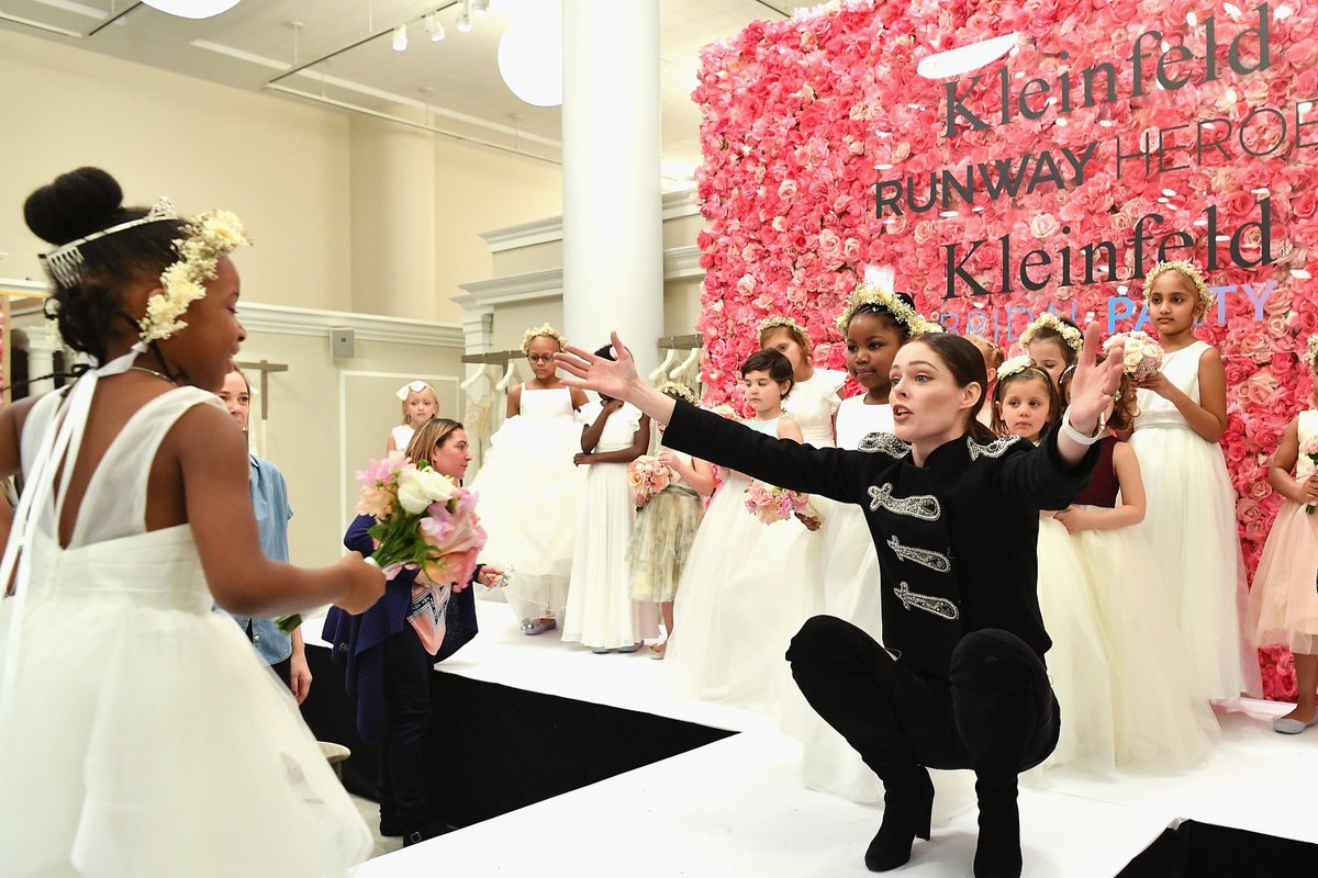 SO SWEET! @cocorocha greets a little model today at the #RunwayHeroes event at @KleinfeldBridal, a fashion show exclusively featuring young girls who are fighting cancer or are in remission, all modeling flower girl dresses. ❤️