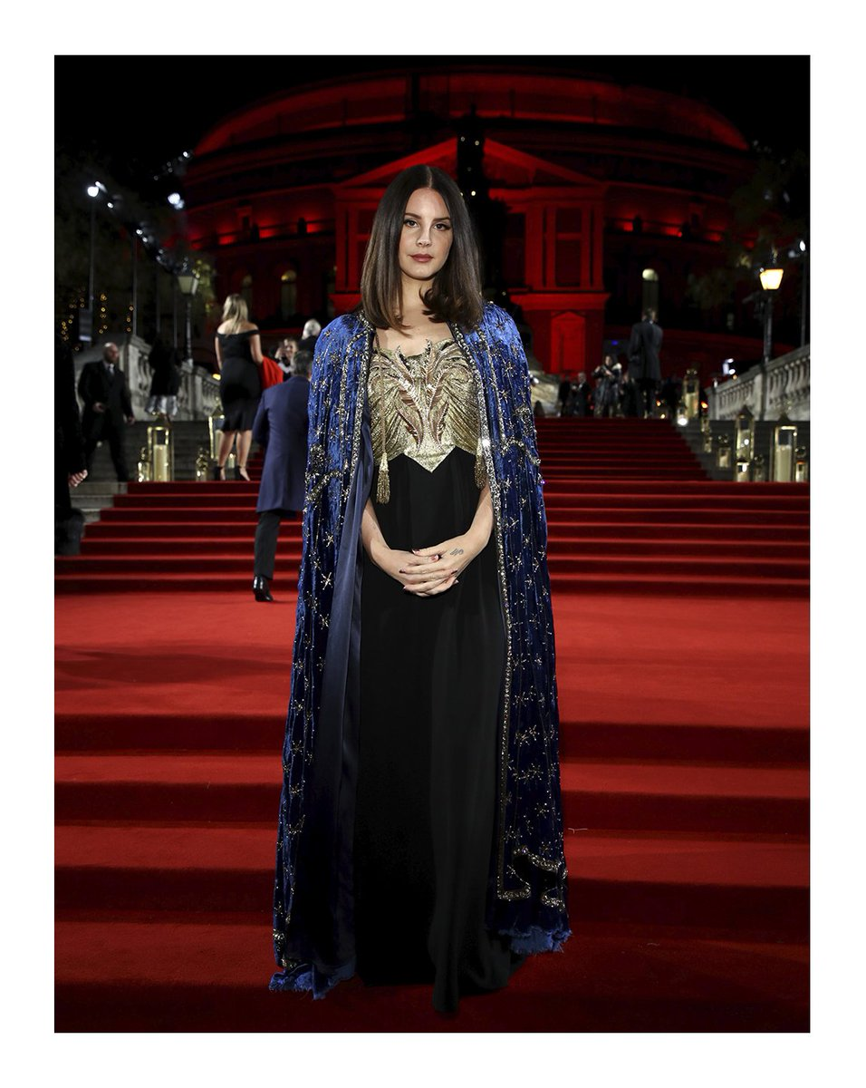 Captured at the @BFC #FashionAwards 2018, @LanaDelRey, the new face of #GucciGuilty wore a custom #Gucci gown with floral appliqués and a #GucciCruise19Cruise19 embroidered velve#LanaDelReyt cape.  presented the Brand of the Year award, accepted by creative d#AlessandroMicheleirector .