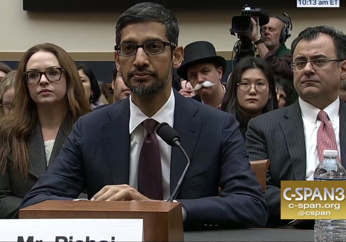 Is that ... the Monopoly Man sitting behind Google's @sundarpichai? #GoogleHearing