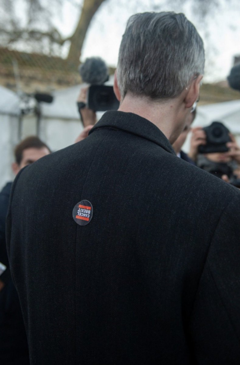 Is someone going to tell him? Someones placed a sticker on the back of Jacob Rees Mogg - during a chat on Collage Green #OldieButGoodie #Brexit 😂