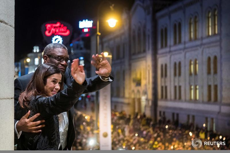 Nobel Peace Prize laureates Denis Mukwege and Nadia Murad wave to people honoring them with a torch lit parade in Oslo, Norway. More photos of the day: http://reut.rs/2QRaFje  📷 NTB Scanpix/Fredrik Hagen