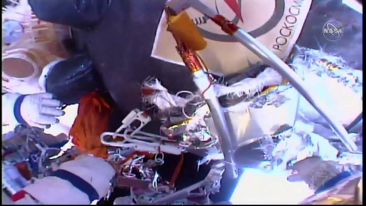 The eureka moment. Spacewalkers find the small black dot where controllers believe the area of the fixed pressure leak is located on the Soyuz crew vehicle. #AskNASA | nasa.gov/live