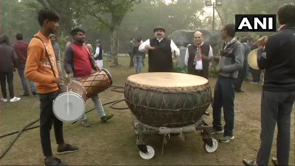 Congress workers celebrate at Delhi's Lodhi Garden. #AssemblyElectionResults2018