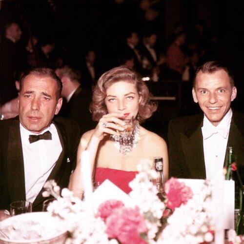 Frank Sinatra was born on this day in 1915. Here are four great photos of a young Frank with original Rat Pack leader Humphrey Bogart and Lauren Bacall, who is the one who gave the legendary group of drinking buddies its name!