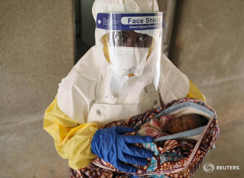 A health care worker carries a baby suspected of being infected with Ebola virus in a hospital in Oicha, and more images from Congo's Ebola zone: https://reut.rs/2QKQOC8 📷 Goran Tomasevic