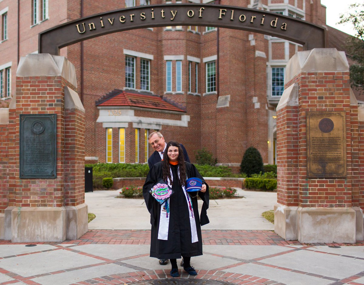 With @ScottStricklin took surprise #ufgrad photos on campus today. On the way back to the office I couldn't resist these photobombs as Shanna Amster was having photos taken by Danielle Marston. <br>http://pic.twitter.com/bR9pKGAuBS