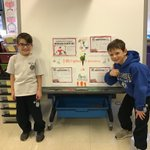 Image for the Tweet beginning: OLW first graders presenting their