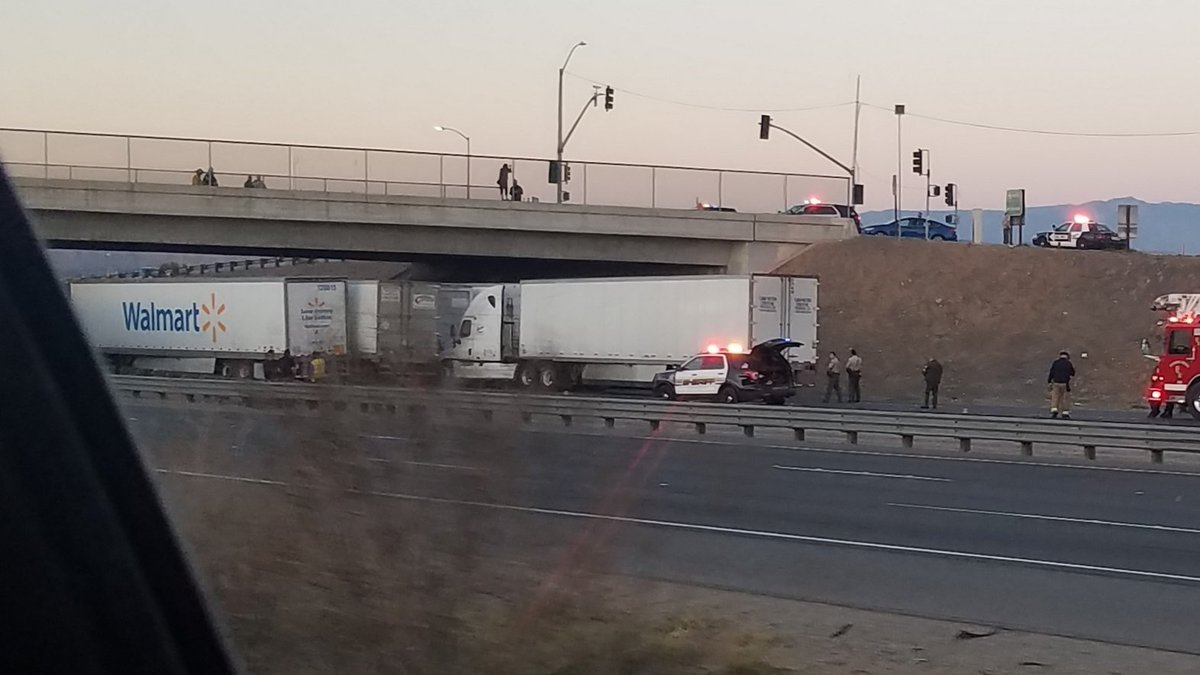 Truckers Line Up Under Overpass To Protect Woman Who