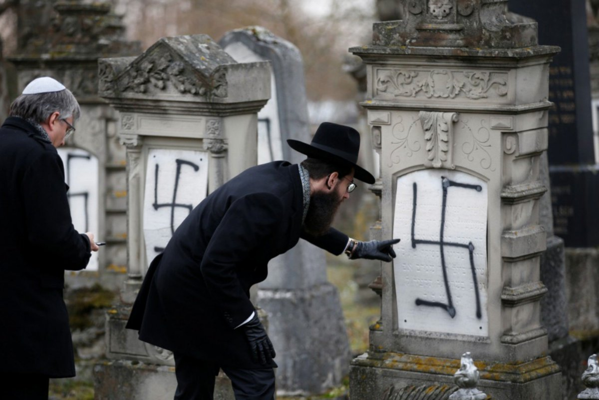 Despicable! Wasnt going to share these pix but this kind of hatred must be called out. Its 2018 and its heartbreaking to see this is still happening. A Strasbourg Rabbi inspects graves desecrated with swastikas in the Jewish cemetery of Herrlisheim, France - via @reuters